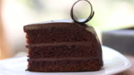 4K:Cutting slice of cake with chocolate video