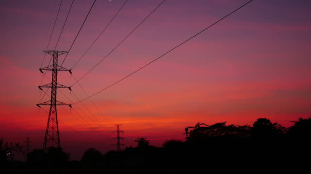 4K:Electricity post with time-lapse at sunset time video