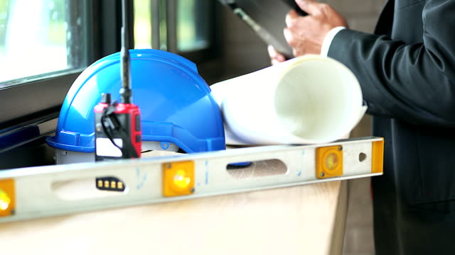 4K:Expert engineer collecting his equipment to preparing for his work at construction site. video