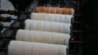 4K:Grill bread rolling in walking street market video
