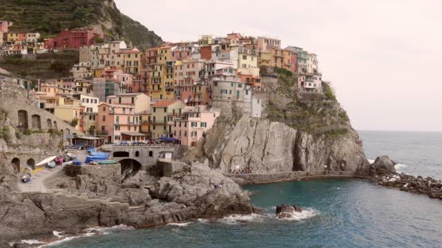 4k,Italy,Village of Manarola, on the Cinque Terre coast of Italy, Seascape in Five lands, Cinque Terre National Park, Liguria Italy Europe.selective focus,vintage color video