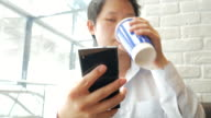 4K:Man Using on cellphone and drinking coffee in cafe video