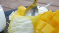 4K:Mango cake Eating Mango Cheese Cake on plate with fresh fruit decoration video