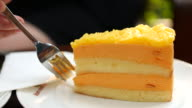4K:Orange cake cream serving and cutting video