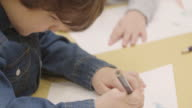 4K:Preschool child drawing and coloring in his classroom video