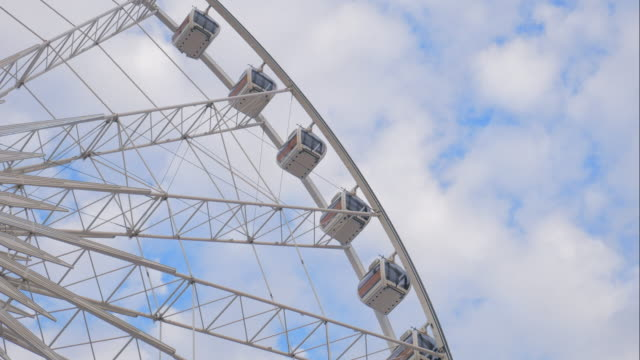 4K:Timelapse of Ferris Wheel and Cloudy sky video