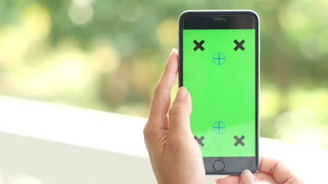 4K:Using smart phone,paning shot,green screen video