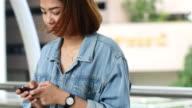 4K:Women using smart phone video