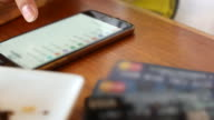 4K:Young man choosing and shopping online by Credit card in Coffee shop video
