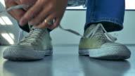 4k:Young Men tying shoelaces video