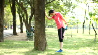 4K:Young woman leg stretching exercises in the Park video