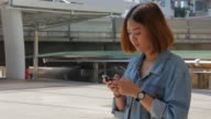 4K:Young Woman Using Smartphone , Rack Focus video