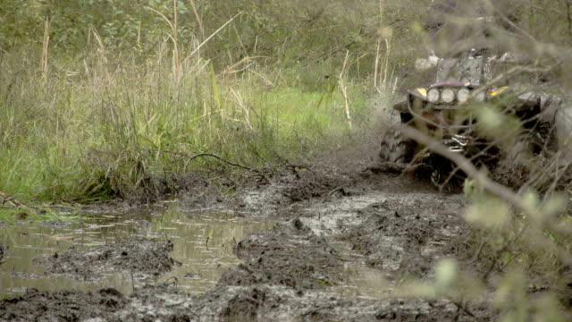 A 4x4 offroad vehicle splunging on the mud video