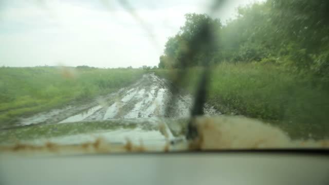 4x4 Truck Driving Down a Muddy Road video