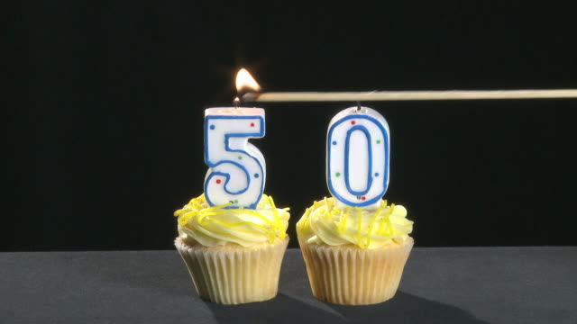 50th anniversary written with lit candles which are blown out video