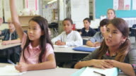 5th grade schoolkids answer questions in class, shot on R3D video