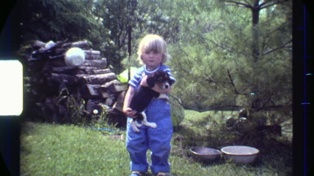 8mm Chubby Blonde Boy holding puppy. Scanned HD video