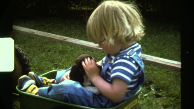 8mm Chubby Blonde Boy playing with puppy. Scanned HD video