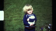 8mm Chubby Blonde Boy with white easter bunny. Scanned HD video