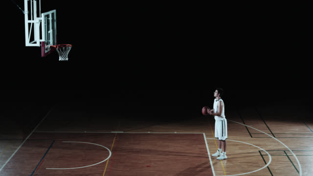 SLO MO of a basketball player shooting from a free throw line video