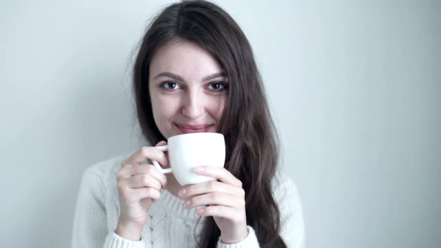 a beautiful woman drinking coffee video