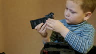 a boy looks at the battery and press the button video