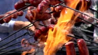 a bunch of sausages on fire in slow motion video