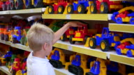 a child in a toy store looking at a car video