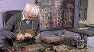 a jeweler creates a bracelet video