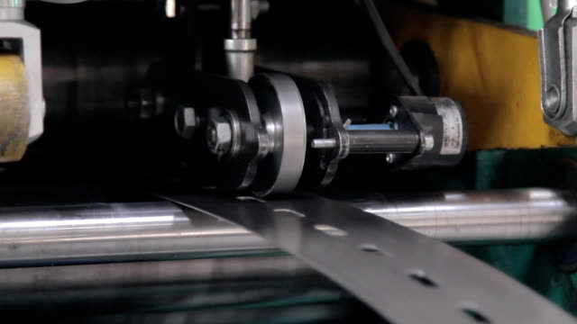 a machine bends perforated metal tape video