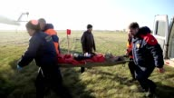 a man on a stretcher into the helicopter are video