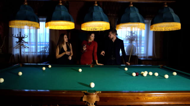 three ladies are playing billiards and having unforgettable threesome  24009