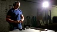 a man preparing to shoot a gun. puts the gun in the holster video