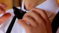a man wears a bow tie video