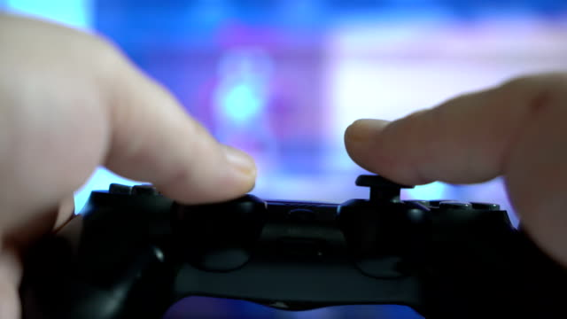 POV of a man with gamepad controller in his hands playing video game video