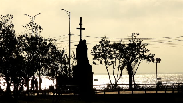 a monument on the waterfront with crosses near the ocean coast video