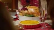 SLO MO of a turkey on a nice plate being brought to the Christmas table video