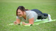 Fat Woman doing plank exercise video