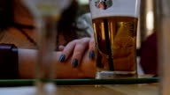 a woman drink beer at the bar video