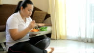 Fat woman eating salad video
