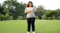 Fat woman measuring her stomach video
