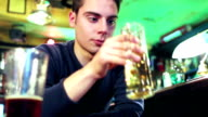 a young man drinks to forget video