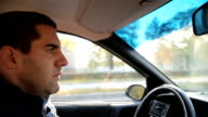a young man driving a car video