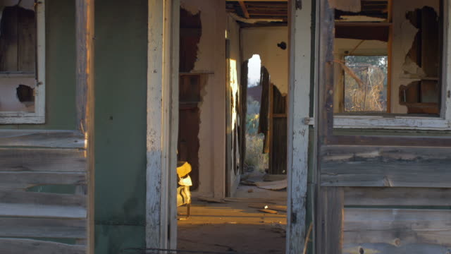 Abandoned dilapidated wood house with old furniture and broken window dolly video