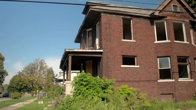 CLOSE UP: Abandoned empty brick built detached family house after being robbed video