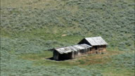 Abandoned Ranch On Grass Plain  - Aerial View - Wyoming,  Sublette County,  helicopter filming,  aerial video,  cineflex,  establishing shot,  United States video