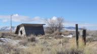 Abandoned shack in field video