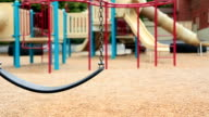 abandoned swings on an empty playground video
