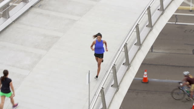 Above Angle Woman Running Over Bridge Downtown video