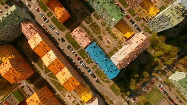 Above top view cozy comfortable colored houses in a European city 4K UHD aerial video